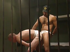 Black hairy guard drills poor prisoner