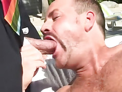 Bear man throats bosses cock outdoor