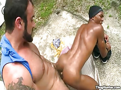 Bear daddy drills young black gay in doggy style